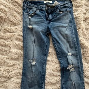 Mid-Rise Ripped Skinny Jeans